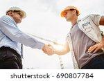 architect engineer shaking... | Shutterstock . vector #690807784
