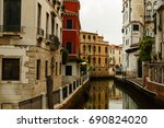narrow canal in venice. | Shutterstock . vector #690824020