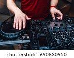 closeup view dj hands on mixer... | Shutterstock . vector #690830950