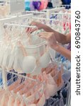 Small photo of Woman chooses a brassiere in a shopping mal of tropical island Bali, Indonesia.