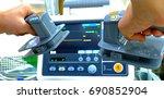 preparing a defibrillator to be ...   Shutterstock . vector #690852904