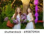 two happy girls. summer outdoor ... | Shutterstock . vector #690870904