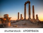 Ancient Ruins With Sun And...