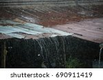 heavy rain on old zinc roof   Shutterstock . vector #690911419