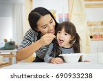 mother and daughter having... | Shutterstock . vector #690933238