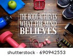 the body achieves what the mind ... | Shutterstock . vector #690942553