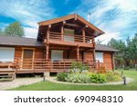 A Modern Wooden House Made Of...