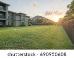 view from grassy backyard of a... | Shutterstock . vector #690950608