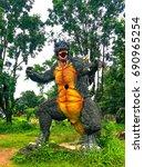 Small photo of Statue of Dino, Stagosaurus and nature