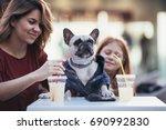 mother and daughter enjoying...   Shutterstock . vector #690992830