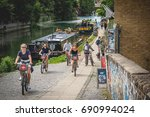 young people cycling along the... | Shutterstock . vector #690994024