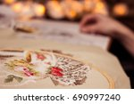 the girl is embroidering a... | Shutterstock . vector #690997240