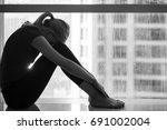 sad woman in the city.   Shutterstock . vector #691002004
