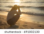 sad and alone young woman... | Shutterstock . vector #691002130