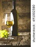 wine. glass of white wine in... | Shutterstock . vector #691002580