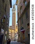 torre del mangia of siena seen... | Shutterstock . vector #691003438