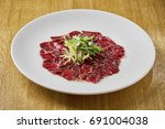 beautiful and tasty food on a... | Shutterstock . vector #691004038
