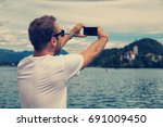 young attractive man doing a... | Shutterstock . vector #691009450