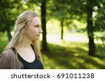 teen girl portrait in green... | Shutterstock . vector #691011238