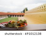 offering at a buddhist temple... | Shutterstock . vector #691012138