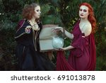 Small photo of Women read a magic book and utter spells, they are witches.