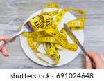 woman trying to eat tape... | Shutterstock . vector #691024648