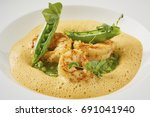 beautiful and tasty food on a... | Shutterstock . vector #691041940