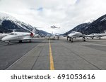 private jets and a helicopter... | Shutterstock . vector #691053616