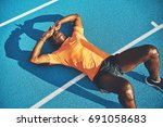tired young athletic african... | Shutterstock . vector #691058683