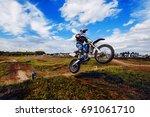 racer on mountain bike... | Shutterstock . vector #691061710