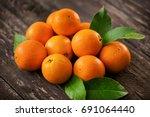 healthy raw orange fruits... | Shutterstock . vector #691064440