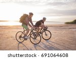two young male on a touring... | Shutterstock . vector #691064608