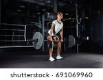 attractive young athlete with... | Shutterstock . vector #691069960