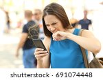 angry woman fed up of her... | Shutterstock . vector #691074448