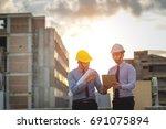 young engineer is working on... | Shutterstock . vector #691075894