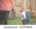 parent taking child to school.... | Shutterstock . vector #691078009