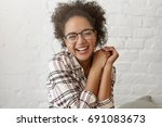 pleased mixed race woman with... | Shutterstock . vector #691083673