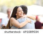 happy couple or friends hugging ... | Shutterstock . vector #691089034