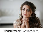 portrait of the bride crying ... | Shutterstock . vector #691090474