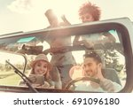 happy young people are smiling... | Shutterstock . vector #691096180