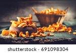 raw wild chanterelles mushrooms ...   Shutterstock . vector #691098304