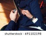 spinner in the man hand | Shutterstock . vector #691102198