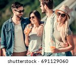 cheerful young people are... | Shutterstock . vector #691129060