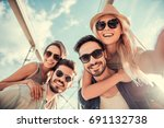 cheerful young people are... | Shutterstock . vector #691132738