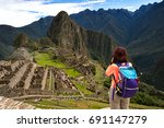 backpacker enjoy view of machu... | Shutterstock . vector #691147279