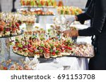 waiter serving catering table... | Shutterstock . vector #691153708