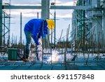 welder welding worker in the... | Shutterstock . vector #691157848