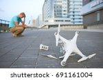 drone crash. fallen damaged... | Shutterstock . vector #691161004
