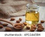 almond oil in glass bottle and... | Shutterstock . vector #691166584