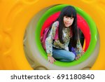 Small photo of Asian kid fun and happy from play a donus ring in playgroung in her pre school, outdoor, kid,children, education concept